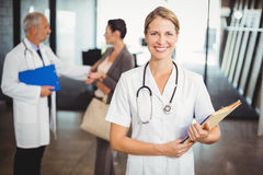 Portrait of a smiling female doctor in hospital Royalty Free Stock Images