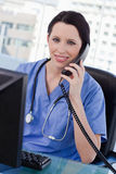 Portrait of a smiling female doctor on the phone Royalty Free Stock Photos