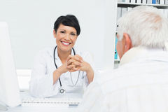 Portrait of a smiling female doctor with senior patient Stock Photography