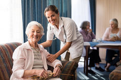 Portrait of smiling female doctor with senior woman Royalty Free Stock Image