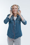 Portrait of smiling female that enjoying music Stock Photos