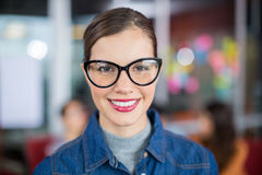Portrait of smiling female executive wearing spectacles Royalty Free Stock Photography