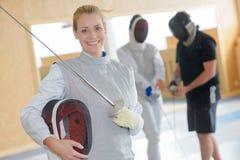 Portrait smiling female fencer Royalty Free Stock Photography