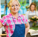 Portrait Of Smiling Female Florist In Shop Royalty Free Stock Images