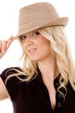 Portrait of smiling female holding hat Royalty Free Stock Images