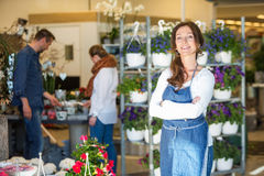 Portrait Of Smiling Female Owner In Flower Shop Stock Photo