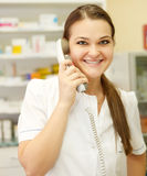 Portrait of a smiling female pharmacist on the phone Stock Photo