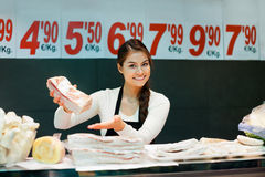Portrait of smiling female seller offering salo and lard Royalty Free Stock Image