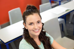 Portrait of smiling female student in classroom Royalty Free Stock Images