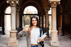 Portrait of a smiling female student showing thumb up outdoors Stock Images