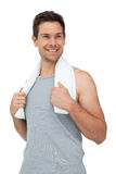 Portrait of a smiling fit young man with towel Stock Photography