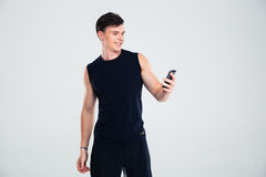 Portrait of a smiling fitness man using smartphone Stock Photography