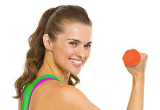 Portrait of smiling fitness woman with dumbbells Stock Photo