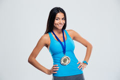 Portrait of a smiling fitness woman with medal Royalty Free Stock Photography