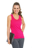Portrait of smiling fitness young woman with clipboard Royalty Free Stock Photography