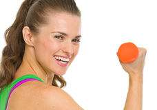 Portrait of smiling fitness young woman with dumbbell Stock Images