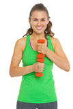 Portrait of smiling fitness young woman with dumbbells Royalty Free Stock Photo