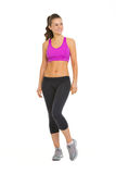 Portrait of smiling fitness young woman looking on copy space Royalty Free Stock Images