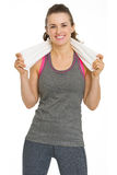 Portrait of smiling fitness young woman with towel Royalty Free Stock Images