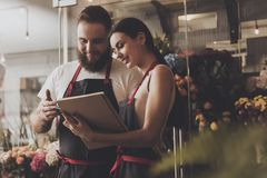 Portrait of smiling florists man and woman stock photo