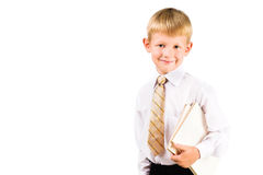 Portrait of a smiling formal boy with books Royalty Free Stock Photos