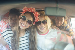Portrait of smiling friends in camper van seen through windshield Royalty Free Stock Photos