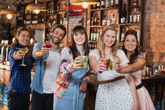 Portrait of smiling friends holding drinks Royalty Free Stock Photo