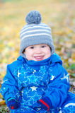 Portrait of smiling funny baby boy in autumn Stock Photo