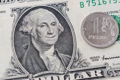 Portrait of smiling George Washington on 1 dollar bill. With one ruble coin. Closeup stock photography