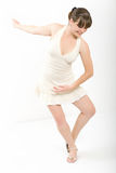 Portrait of the smiling girl. The dancing girl in a white dress royalty free stock photo