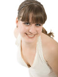 Portrait of the smiling girl. The dancing girl in a white dress royalty free stock photography