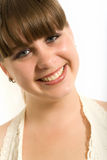 Portrait of the smiling girl. The girl in a white dress stock photography