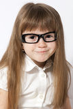 A portrait of the smiling girl. Wearing glasses Stock Images
