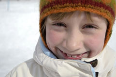 Child in winter. Portrait of a smiling girl Royalty Free Stock Photos