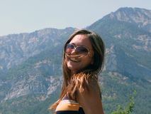 Portrait of the smiling girl. Portrait of the smiling beautiful girl on a background of mountains Stock Photos