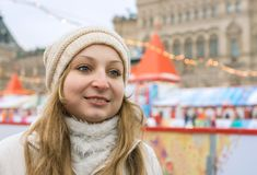 Portrait of smiling girl against city square Royalty Free Stock Images