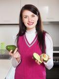 Portrait of smiling girl with avocado Stock Photos