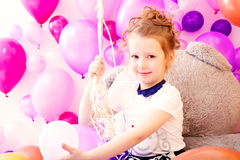 Portrait of smiling girl on balloons background Royalty Free Stock Photo