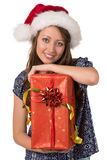 Portrait of smiling girl with big Christmas present. Royalty Free Stock Photos