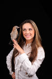 Portrait of smiling girl with bird Stock Photo