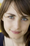 Portrait of smiling girl with blue eyes Royalty Free Stock Images