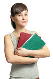 Portrait of a smiling girl with books Stock Photo