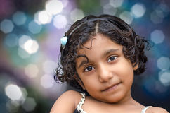 Portrait of smiling girl child. At night with bokeh colorful background stock photography