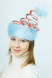 Portrait of smiling girl in Christmas hats Stock Photos