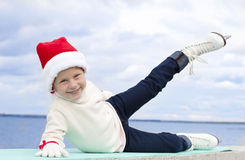 Portrait of a smiling girl in a Christmas skating Royalty Free Stock Photo