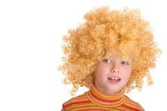 Portrait of smiling girl in curly wig. Royalty Free Stock Photo