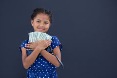 Portrait of smiling girl embracing currency Stock Images