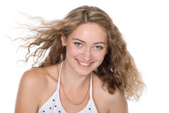 Portrait of smiling girl with a flying hair Stock Photo