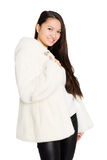 Portrait of a smiling girl in a fur coat. Stock Photos
