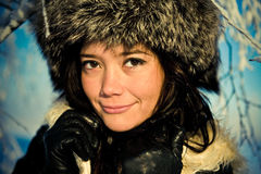 Portrait of smiling girl in a fur hat. Cute portrait of smiling girl in a fur hat Stock Photo